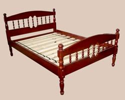 Кровать двуспальная из массива сосны резная сполуовалом